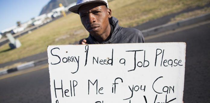 A man offers his services at a traffic intersection in Cape Town. Almost 55% of South African youth are unemployed. EFE-EPA/Nic Bothma