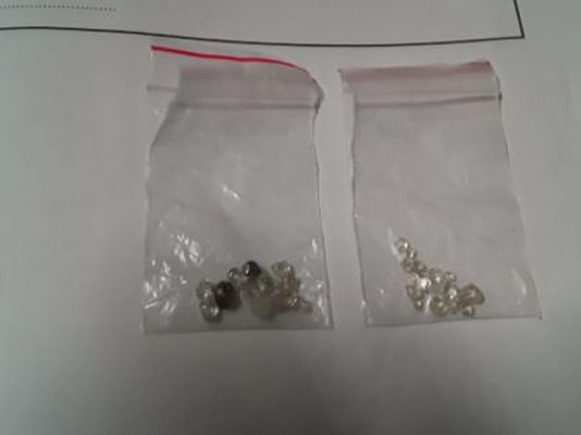Two men bust for being in possession of 27 uncut diamonds, Bellville. Photo: SAPS