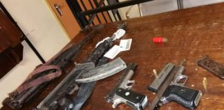 Two nabbed with AK47 rifles, pistols and cash, Mthatha. Photo: SAPS