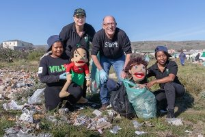 At the Mandela Day initiative to clean up an area in Bethelsdorp yesterday were (from left) Brenda Jonas, with mascot Zisa, Kay Hardy, SPAR EC sponsorships and events manager Alan Stapleton and Emmy Nxayeka, with mascot Nondalo. Photo: Leon Hugo