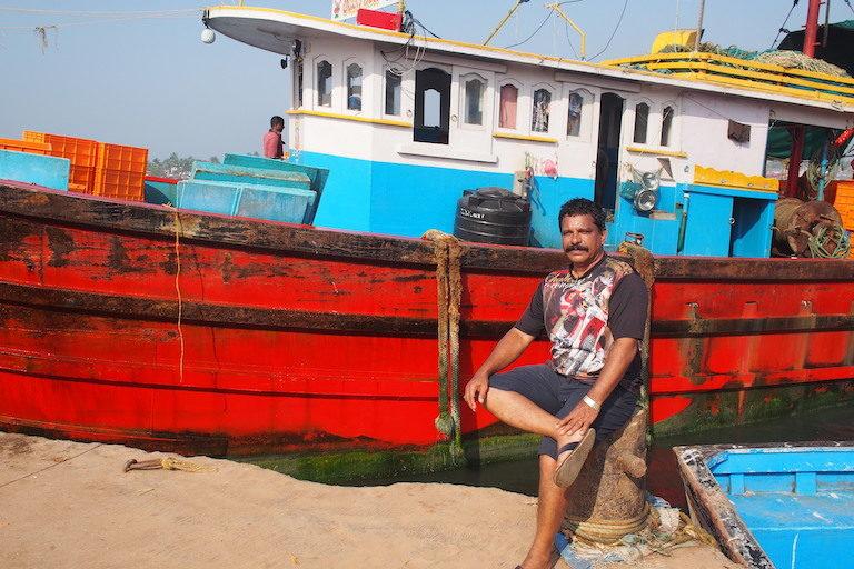 A fisher in Mangalore harbor. Image by Vaishnavi Chandrashekhar.