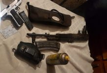 Taxi operator arrested with array of firearms, Boitekong. Photo: SAPS