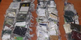 Three loan sharks arrested with SASSA cards and IDs, Keimoes. Photo: SAPS