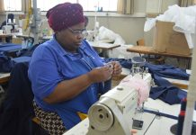 Zethu Soya, of Port Elizabeth, goes through her daily job as a seamstress at the Association for Persons with Physical Disabilities in Port Elizabeth. She says her life has been changed since receiving a wheelchair through the SPAR Wheelchair Wednesday campaign. Photo: Full Stop Communications