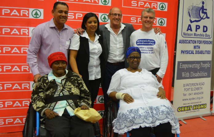 At the SPAR Wheelchair Wednesday handover function at the Nelson Mandela Stadium in Port Elizabeth yesterday were (back, from left) Selwyn Willis, of KingfisherFM, Debadene Baatjies and Alan Stapleton, of SPAR Eastern Cape, Brian Bezuidenhout of APD (front) and recipients Mavis Holloway (left) and Ephetia Trato. Photo: Full Stop Communications