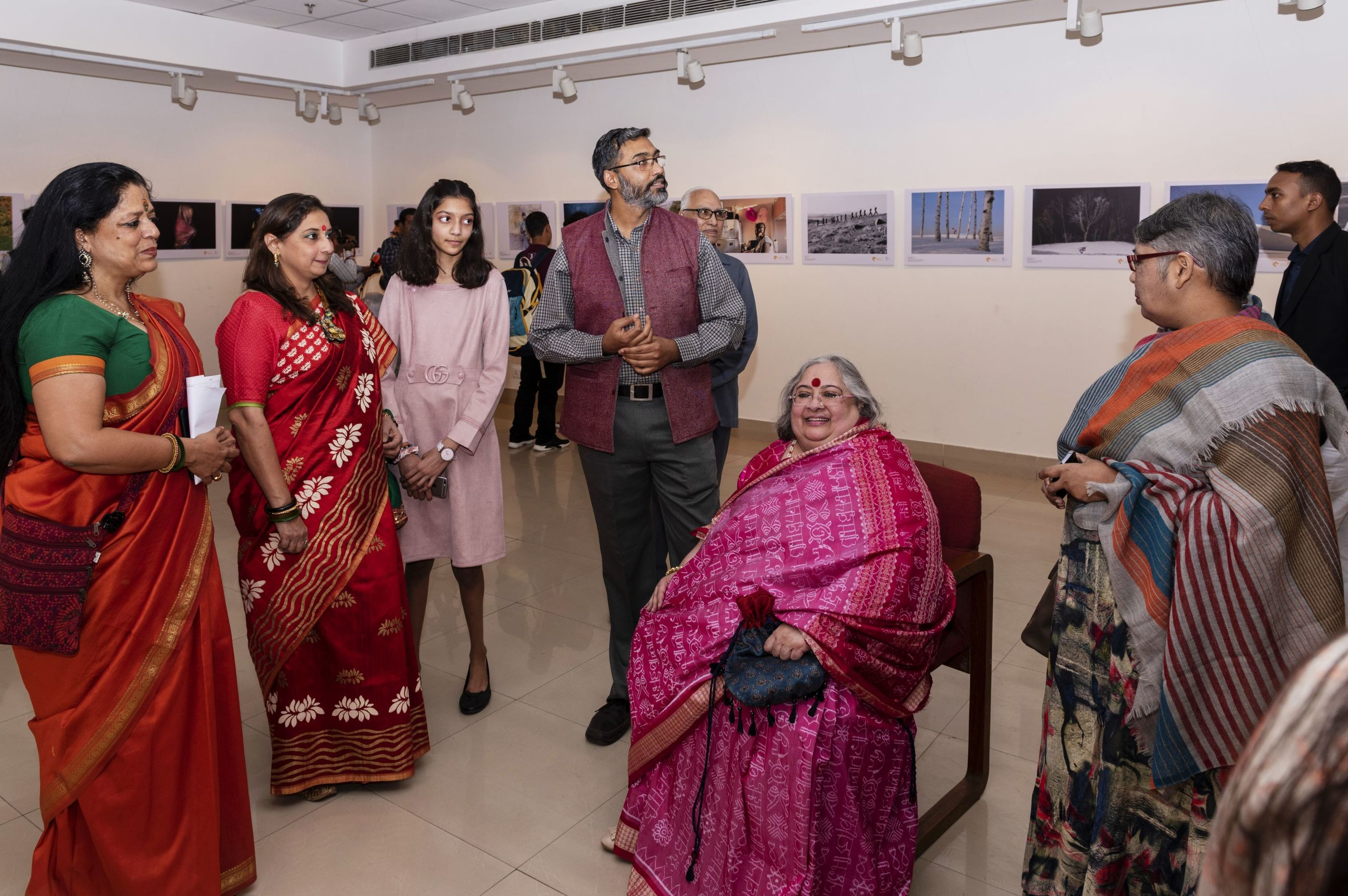 Painter, designer, art curator Alka Raghuvanshi (in the middle) at the winners exhibition of the Andrei Stenin International Photo Contest at the AIFACS Gallery in New Delhi.