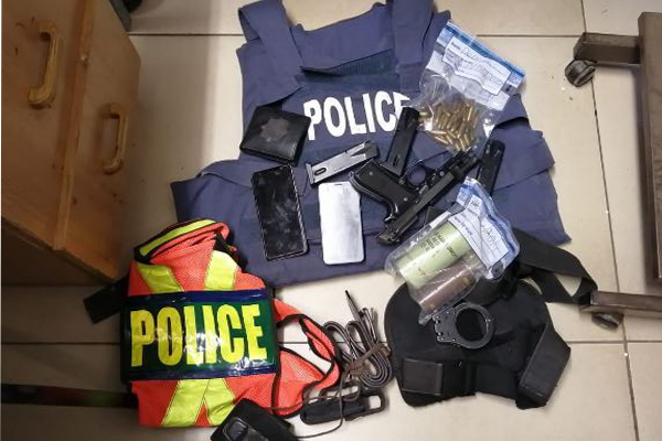 Man arrested with police gear, gets bail, rearrested again for stolen SAPS firearm. Photo: SAPS