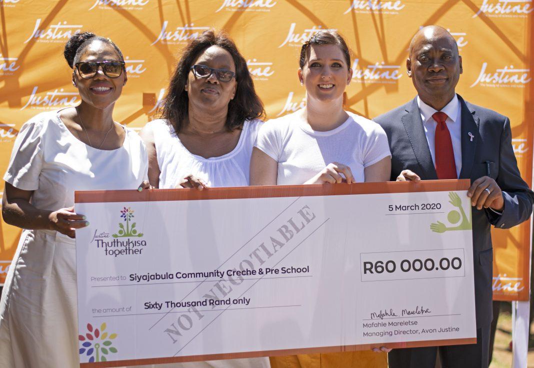 Principal of Embo Pre-School shouts for joy at the generosity of Johannesburg based beauty company