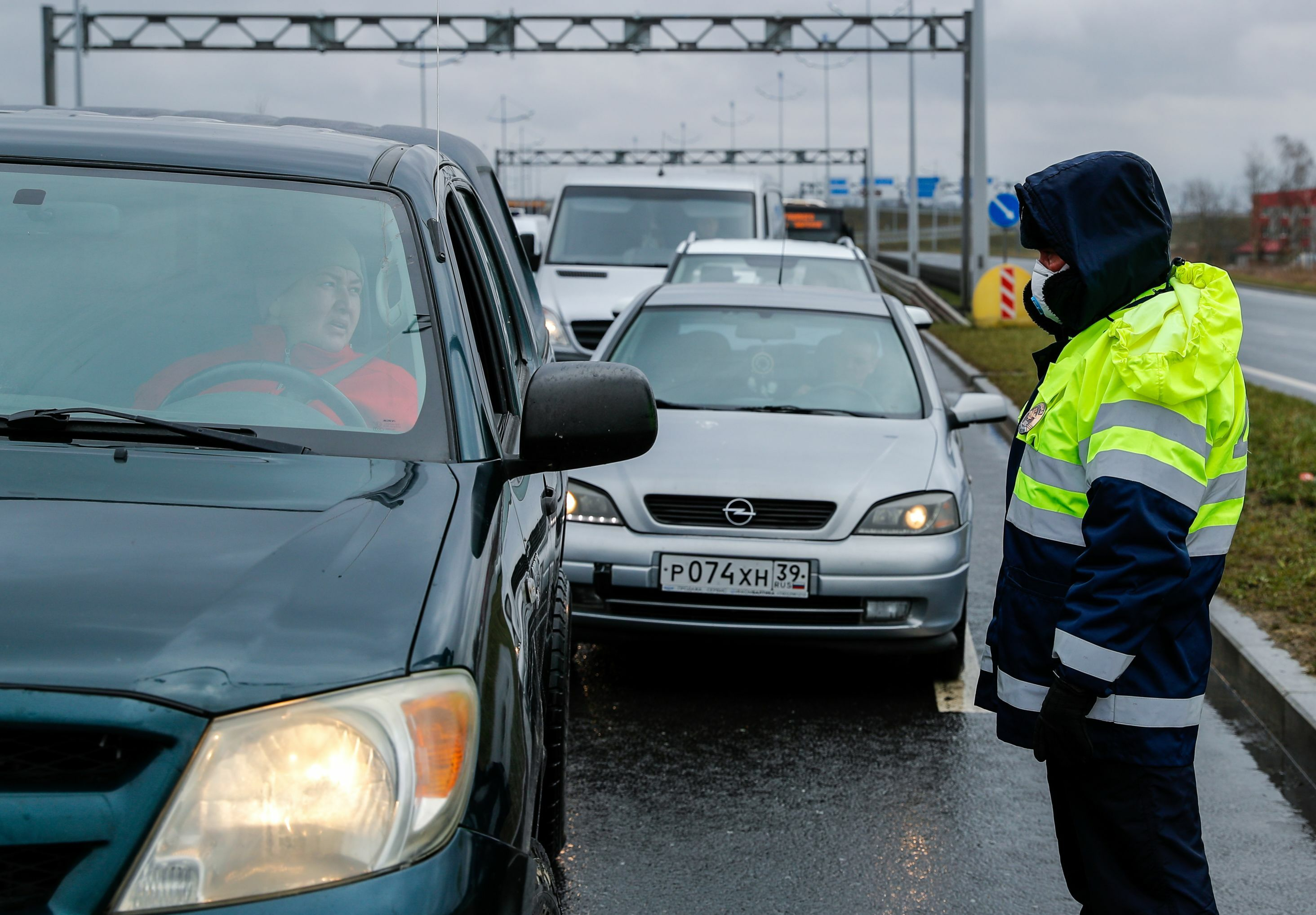 A police officer talks to a driver at a check point, after local authorities tightened up measures to prevent the spread of coronavirus disease (COVID-19), in Kaliningrad, Russia.