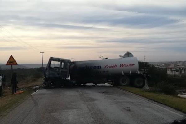 Mob barricade road, torch water truck, Uitenhage. Photo: SAPS