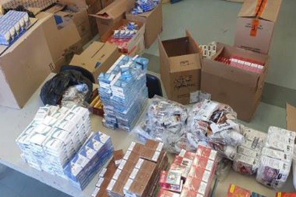 R241k worth of cigarettes and R119k cash recovered, Springbok. Photo: SAPS